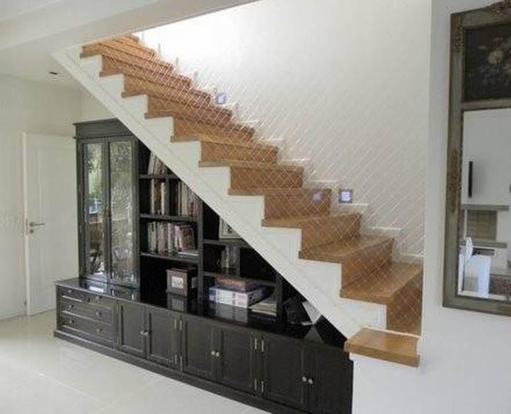 Decoracion escaleras duplex dplex con escalera de caracol for Aprovechar hueco escalera duplex